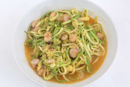 fresh and raw zucchini spaguetti with prawns as imitation of italian pasta for vegetarian food