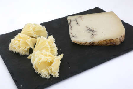 pecorino with truffle and cheese rosettes as delicatessen gourmet food