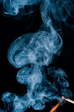 burning match with smoke photo