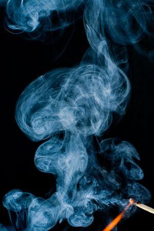 burning match with smoke photo