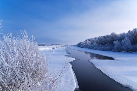 frozen river: winter landsape with frozen river
