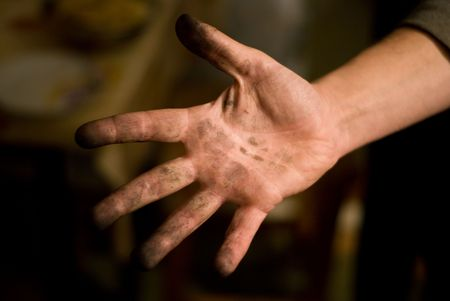soot: a hand soiled with soot of a working man
