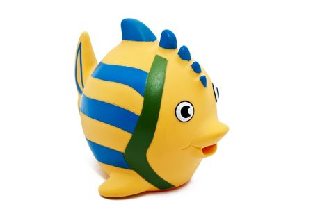 a rubber yellow fish with blue stripes Stock Photo - 6619887