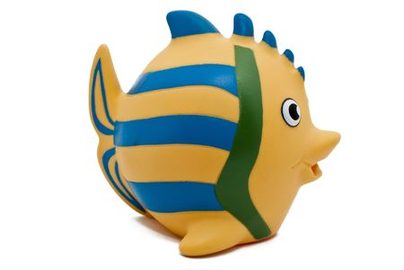 a rubber yellow fish with blue stripes Stock Photo - 6619886