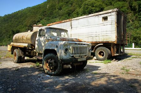 an old russian rusty trailer truck   photo