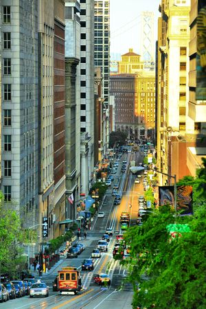city living: Golden California St., San Francisco, CA, opposite a golden sunset, with streetcars Stock Photo
