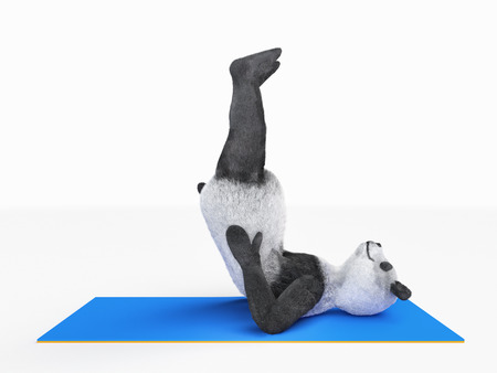 legs up: panda lies on back and pulls legs up on blue mat  Stock Photo