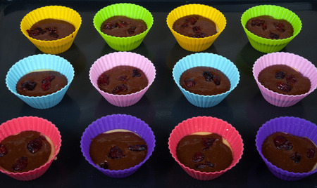 roasting pan: Twelve chocolate muffins form with dough on a roasting pan Stock Photo