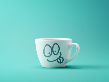 Face Laughing Coffee Cup Concept isolated on cyan background Stock Photo