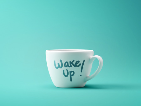 Wake Up Coffee Cup Concept isolated on cyan background Archivio Fotografico