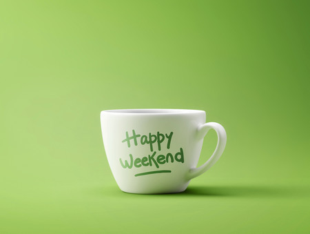 Happy Weekend Coffee Cup Concept isolated on green background