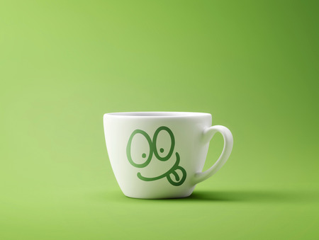 Face Laughing Coffee Cup Concept isolated on green background