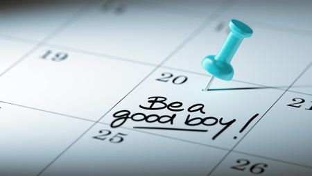 good boy: Concept image of a Calendar with a blue push pin. Closeup shot of a thumbtack attached. The words Be a good boy written on a white notebook to remind you an important appointment.