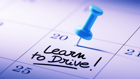 school exam: Concept image of a Calendar with a blue push pin. Closeup shot of a thumbtack attached. The words Learn to Drive written on a white notebook to remind you an important appointment.