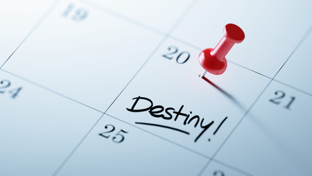 Concept image of a Calendar with a red push pin. Closeup shot of a thumbtack attached. The words Destiny written on a white notebook to remind you an important appointment. Stock Photo