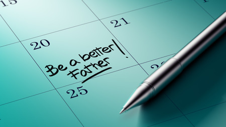 better days: Closeup of a personal agenda setting an important date written with pen. The words Be a better father written on a white notebook to remind you an important appointment. Stock Photo