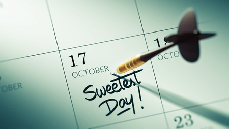 sweetest: Concept image of a Calendar with a golden dart stick. The words Sweetest Day written on a white notebook to remind you an important appointment. Stock Photo