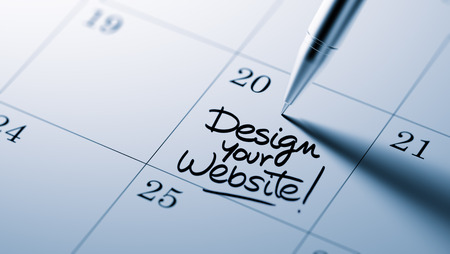 redesign: Closeup of a personal agenda setting an important date written with pen. The words Design your website written on a white notebook to remind you an important appointment.