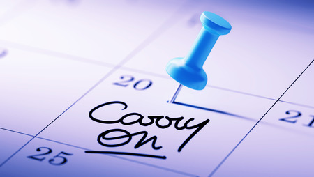 and carry on: Concept image of a Calendar with a blue push pin. Closeup shot of a thumbtack attached. The words Carry on written on a white notebook to remind you an important appointment. Stock Photo