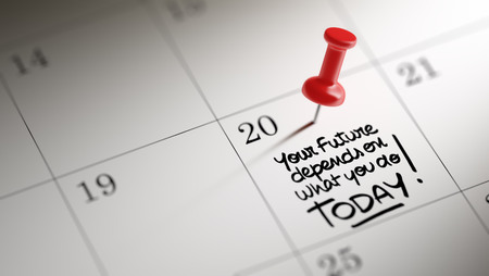 depends: Concept image of a Calendar with a red push pin. Closeup shot of a thumbtack attached. The words Your future depends on what you do today written on a white notebook to remind you an appointment. Stock Photo