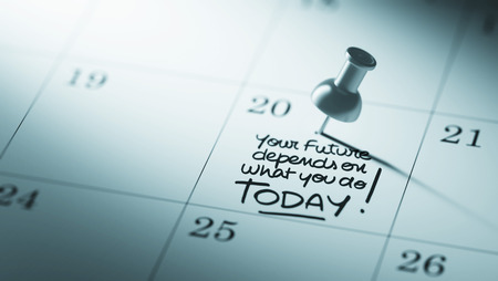 depends: Concept image of a Calendar with a push pin. Closeup shot of a thumbtack attached. The words Your future depends on what you do today written on a white notebook to remind you an appointment. Stock Photo