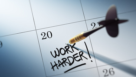 harder: Concept image of a Calendar with a golden dart stick. The words Work Harder written on a white notebook to remind you an important appointment. Stock Photo