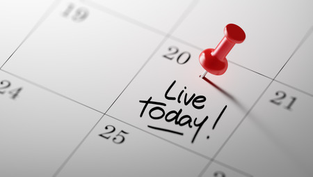 living moment: Concept image of a Calendar with a red push pin. Closeup shot of a thumbtack attached. The words Live today written on a white notebook to remind you an important appointment. Stock Photo