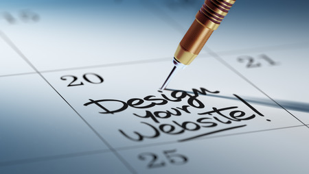 website words: Concept image of a Calendar with a golden dart stick. The words Design your website written on a white notebook to remind you an important appointment.
