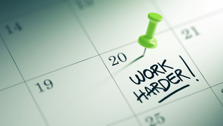 hard day at the office: Concept image of a Calendar with a green push pin. Closeup shot of a thumbtack attached. The words Work Harder written on a white notebook to remind you an important appointment. Stock Photo
