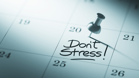 dont: Concept image of a Calendar with a push pin. Closeup shot of a thumbtack attached. The words Dont Stress written on a white notebook to remind you an important appointment.