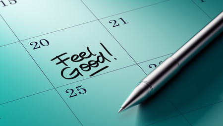 better days: Closeup of a personal agenda setting an important date written with pen. The words Feel Good written on a white notebook to remind you an important appointment. Stock Photo