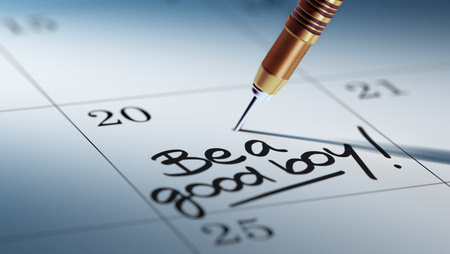 good boy: Concept image of a Calendar with a golden dart stick. The words Be a good boy written on a white notebook to remind you an important appointment.