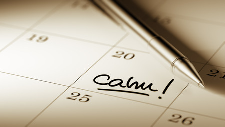 reflexive: Closeup of a personal agenda setting an important date written with pen. The words Calm written on a white notebook to remind you an important appointment.