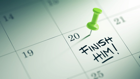 liquidate: Concept image of a Calendar with a green push pin. Closeup shot of a thumbtack attached. The words Finish Him written on a white notebook to remind you an important appointment. Stock Photo