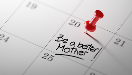 mother to be: Concept image of a Calendar with a red push pin. Closeup shot of a thumbtack attached. The words Be a better mother written on a white notebook to remind you an important appointment.