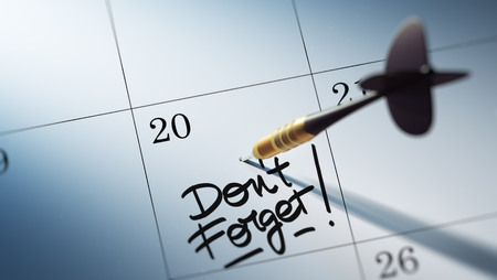 don't: Concept image of a Calendar with a golden dart stick. The words Don`t Forget written on a white notebook to remind you an important appointment.