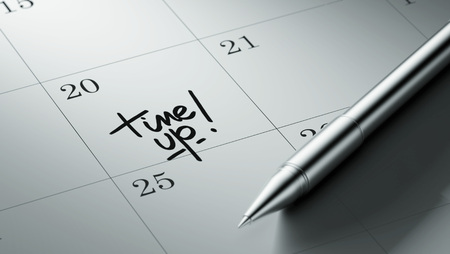 important date: Closeup of a personal agenda setting an important date written with pen. The words Time up written on a white notebook to remind you an important appointment.
