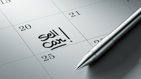 sell car: Closeup of a personal agenda setting an important date written with pen. The words Sell Car written on a white notebook to remind you an important appointment. Stock Photo
