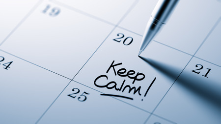 peace plan: Closeup of a personal agenda setting an important date written with pen. The words Keep Calm written on a white notebook to remind you an important appointment. Stock Photo