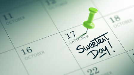 sweetest: Concept image of a Calendar with a green push pin. Closeup shot of a thumbtack attached. The words Sweetest Day written on a white notebook to remind you an important appointment.