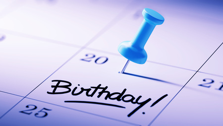 calendar date: Concept image of a Calendar with a blue push pin. Closeup shot of a thumbtack attached. The words Birthday written on a white notebook to remind you an important appointment.
