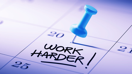 hard day at the office: Concept image of a Calendar with a blue push pin. Closeup shot of a thumbtack attached. The words Work Harder written on a white notebook to remind you an important appointment.