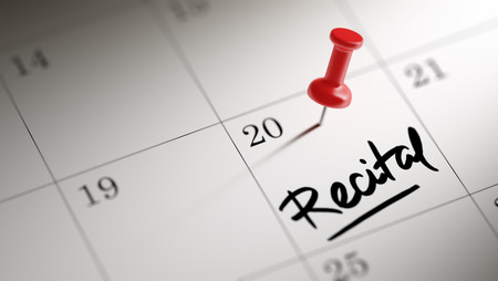 recital: Concept image of a Calendar with a red push pin. Closeup shot of a thumbtack attached. The words Recital written on a white notebook to remind you an important appointment.
