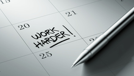 harder: Closeup of a personal agenda setting an important date written with pen. The words Work Harder written on a white notebook to remind you an important appointment.