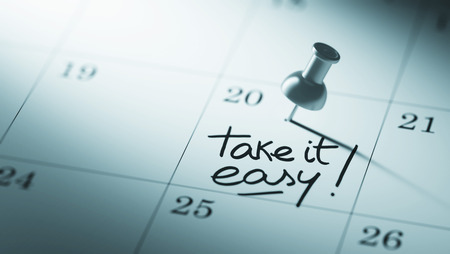 take it easy: Concept image of a Calendar with a push pin. Closeup shot of a thumbtack attached. The words Take it easy written on a white notebook to remind you an important appointment.