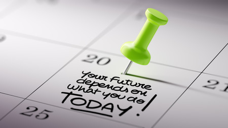 depends: Concept image of a Calendar with a green push pin. Closeup shot of a thumbtack attached. The words Your future depends on what you do today written on a white notebook to remind you an appointment. Stock Photo