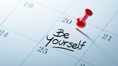 be yourself: Concept image of a Calendar with a red push pin. Closeup shot of a thumbtack attached. The words be yourself written on a white notebook to remind you an important appointment.