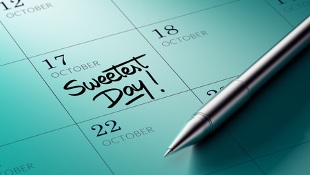 sweetest: Closeup of a personal agenda setting an important date written with pen. The words Sweetest Day written on a white notebook to remind you an important appointment.