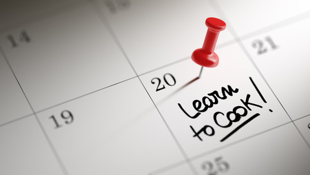 event calendar: Concept image of a Calendar with a red push pin. Closeup shot of a thumbtack attached. The words Learn to Cook written on a white notebook to remind you an important appointment.