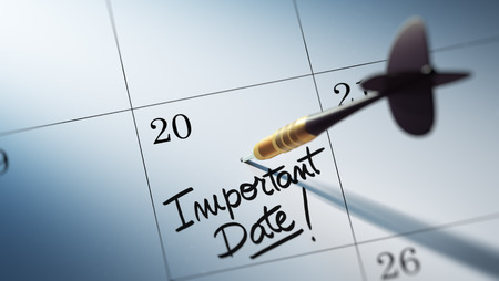 important date: Concept image of a Calendar with a golden dart stick. The words Important date written on a white notebook to remind you an important appointment. Stock Photo